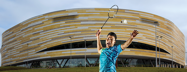 Badminton player in front of Derby Arena