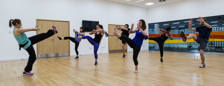 Group kicking in group exercise class at Derby Arena.