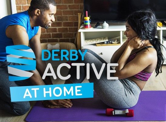 Active at home - coach with woman doing sit-ups in living room