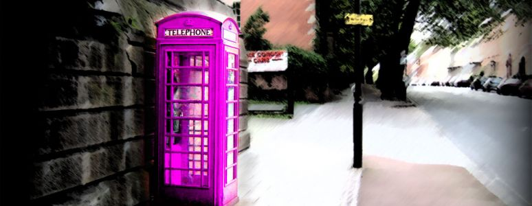 Old fashioned phone box on street scene