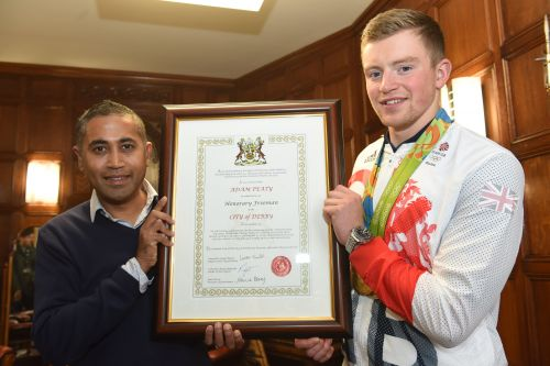 Adam Peaty with Cllr Ranjit Banwait at the reception outside the ceremonial entrance of the Council House